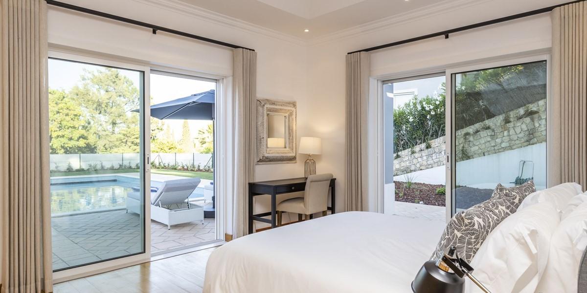 Bright Bedroom With Double Aspect Patio Doors To Garden