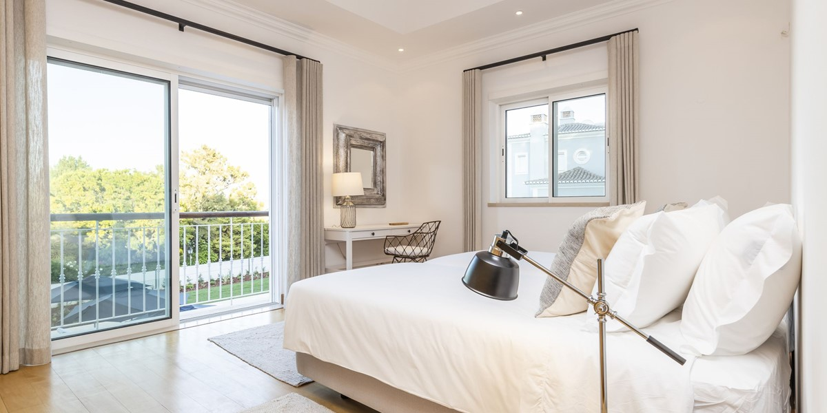 Twin Bedroom With Juliet Balcony Views To The Pool And Garden