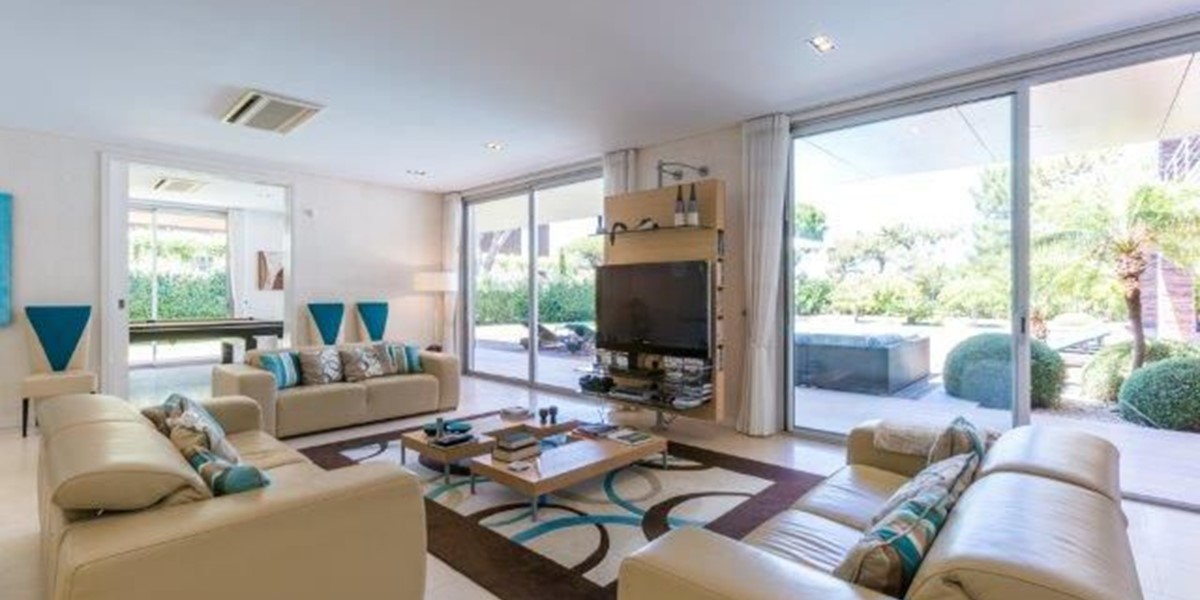 Living Room With Access To Covered Terrace And Pool